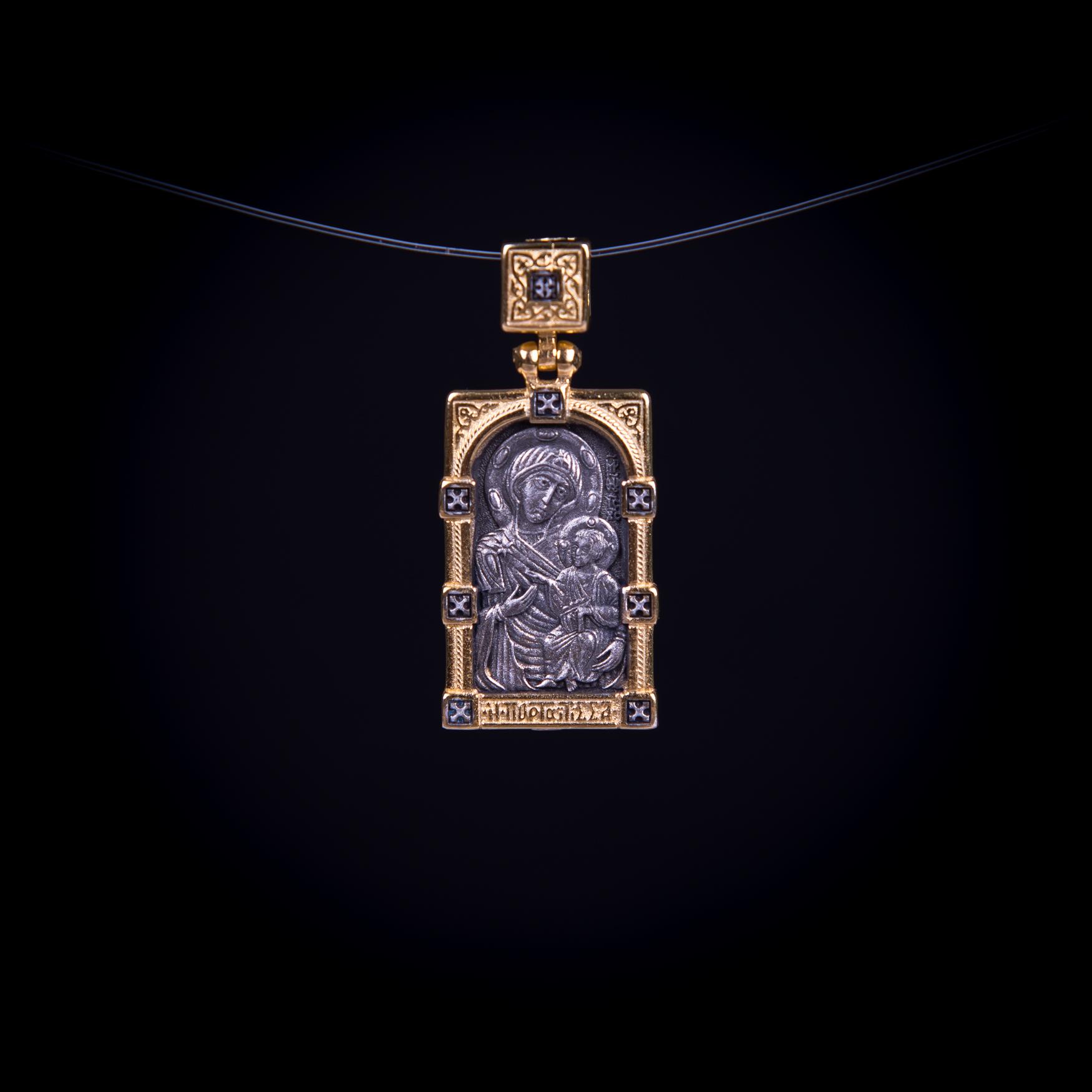 003/0048  A medal of virgin Mary